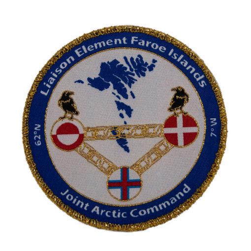 vøvede emblemer
